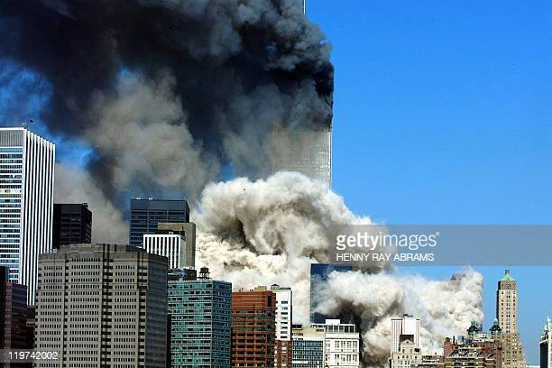 Smoke billows up after the first of the two towers of the World Trade Center collapses 11 September 2001 Two planes were crashed into the twin towers...