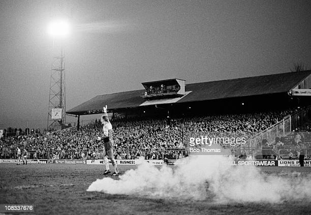 A smoke bomb explodes behind Norwich City goalkeeper Bryan Gunn during their Division One match against Millwall played at The Den London on 22nd...