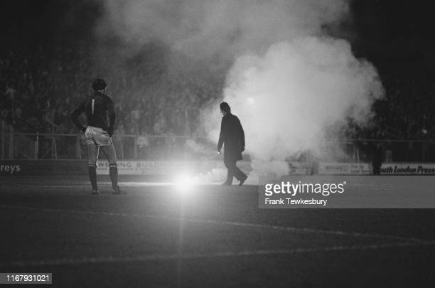 Smoke bomb on the ground at The Den, home of Millwall Football Club, during a match against Chelsea FC, London, UK, 10th October 1984.