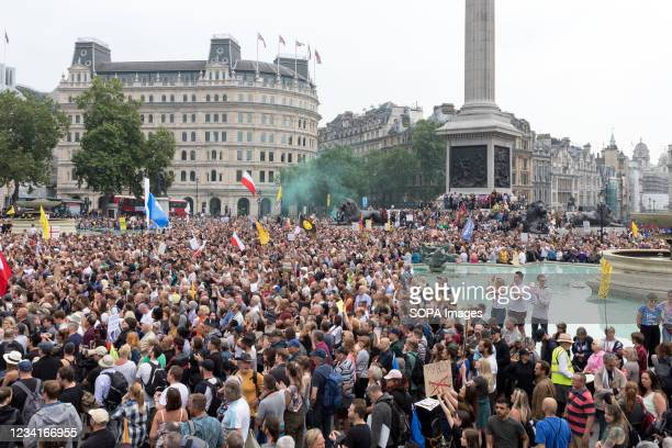 Smoke bombs being blown off with in a crowd of protesters, during the 24th July Freedom Day London demonstration. The World Wide Rally for Freedom in...
