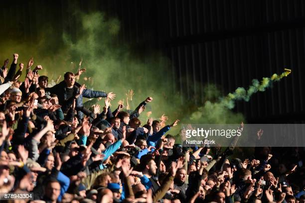 A smoke canister is thrown as Leeds United fans celebrate during the Sky Bet Championship match between Barnsley and Leeds United at Oakwell Stadium...