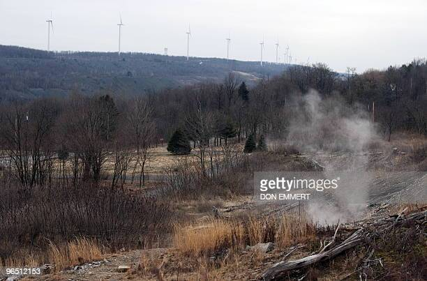 Smoke caused by an underground coal fire rises on a hill overlooking Centralia PA February 2 2010 Power wind mills can be seen in the distance near...