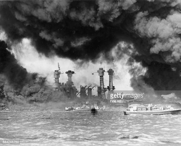Smoke chokes the air during the Japanese attack on Pearl Harbor Hawaii December 7 1941 Silver print US Navy photographer 1941