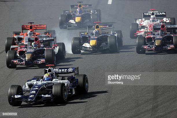 Smoke comes from the car of David Coulthard of Team Red Bull Racing as he breaks hard at the start of the Formula 1Grand Prix of Japan in Suzuka on...