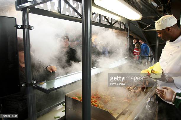 Smoke comes off the grill at the Italian sausage stand during the Georgetown Hoyas and St John's Red Storm game at Citi Field on March 29 2009 in the...