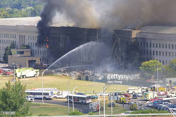 Smoke comes out from the west wing of the Pentagon building September 11 2001 in Arlington Va after a plane crashed into the building and set off a...