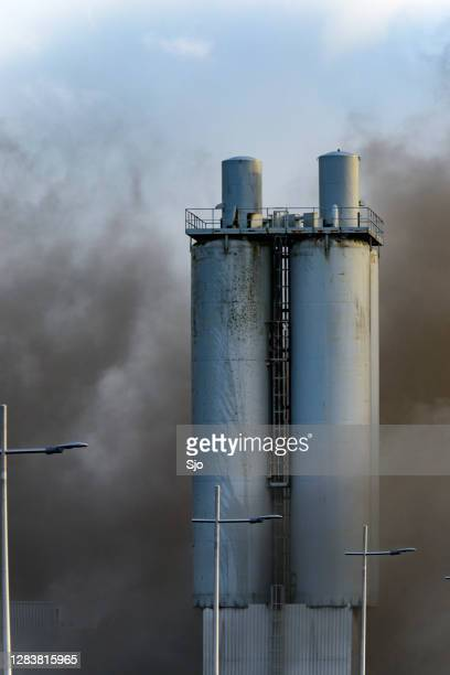 "smoke coming from a scrapyard fire in an industrial aeria - ""sjoerd van der wal"" or ""sjo"" stock pictures, royalty-free photos & images"