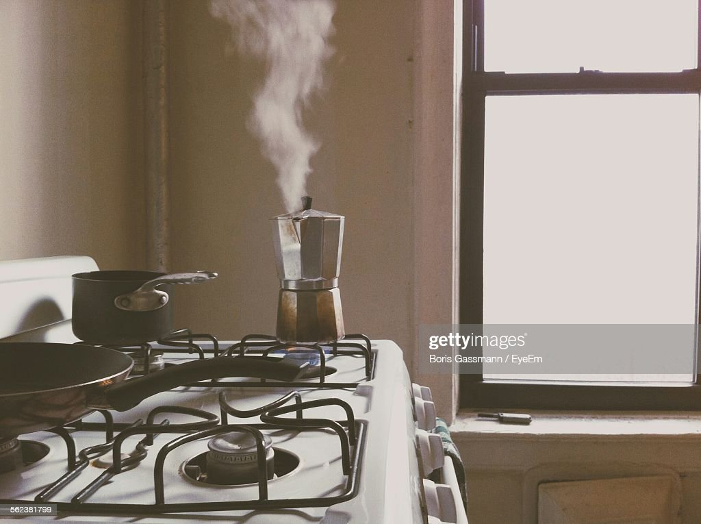 Smoke Coming From Coffee Maker In Kitchen Counter : Stock Photo