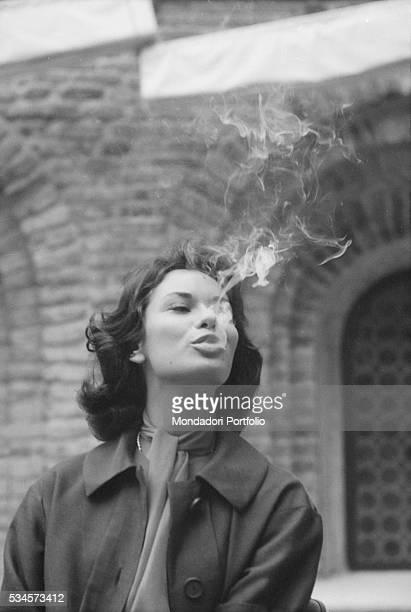 Smoke coming from Italian actress Lea Massari's mouth during the XVIII Venice International Film Festival Venice 1957