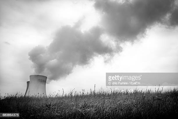 Smoke Coming Out From Factory Pipe Against Cloudy Sky