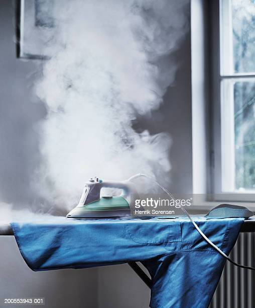 smoke coming out from unattended iron - burning stock pictures, royalty-free photos & images