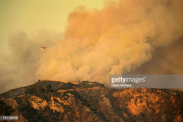 Smoke continues to billow from Griffith Park the nation's largest urban park as a new day begins on May 9 2007 in Los Angeles California The Griffith...