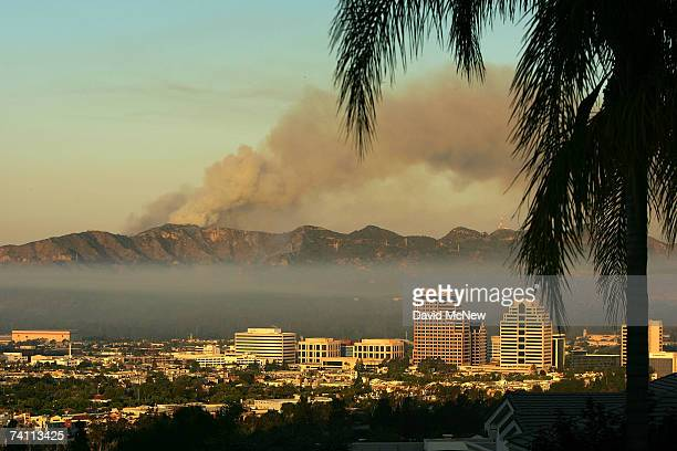 Smoke continues to billow from Griffith Park, the nation's largest urban park, beyond downtown Glendale as a new day begins on May 9, 2007 in Los...