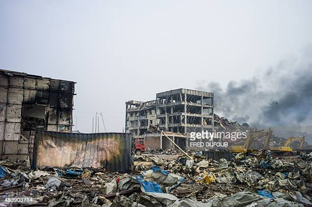 Smoke continues to billow on the second morning after a series of explosions at a chemical warehouse hit the city of Tianjin in northern China on...