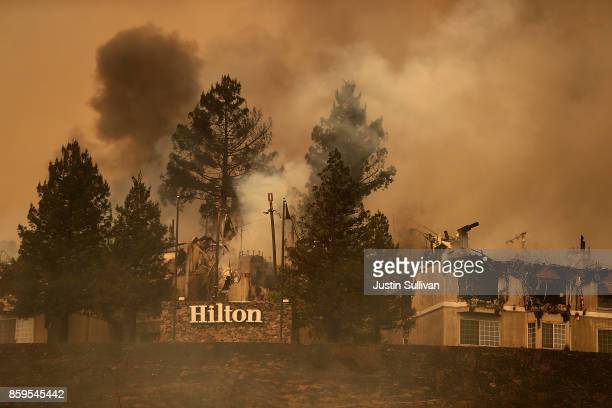 Smoke continues to rise from the Hilton Sonoma Wine Country on October 9 2017 in Santa Rosa California Ten people have died in wildfires that have...