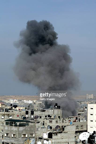 A smoke coulmn rises following an Israeli airstrike on January 5 2009 in Rafah southern Gaza Israel is intensifying its widescale ground assault...