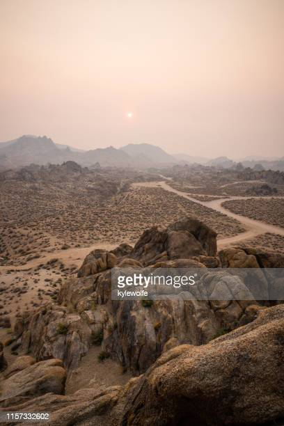 smoke covered desert landscape, alabama hills, lone pine, inyo county, california, united states - lone pine california stock pictures, royalty-free photos & images