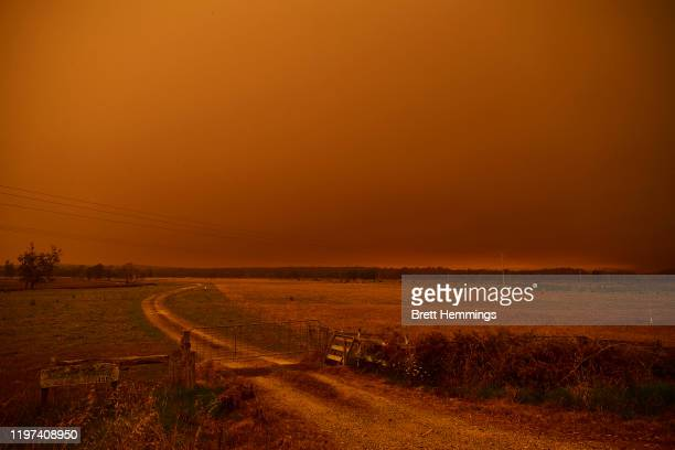Smoke covers the skyline as fires approach the Princess Highway on January 04, 2020 in Bodalla, Australia. A state of emergency has been declared...