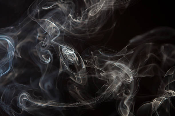 smoke  curls against black background