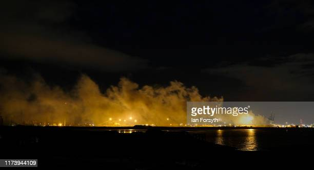Smoke drifts across the industrial skyline of Teesside as a fire rages at a large pile of processed metal on September 11 2019 in Redcar England The...