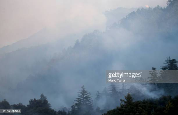 Smoke drifts during the Bobcat Fire in the Angeles National Forest on September 23, 2020 near Pasadena, California. The Bobcat Fire, burning in the...