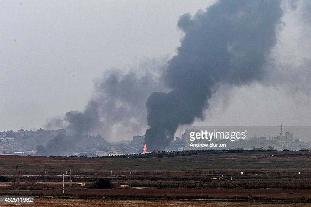 Smoke due to airstrikes and shelling rises from Gaza on July 22 2014 as seen from near Sderot Israel As operation Protective Edge goes into it's...