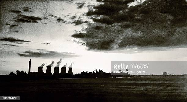 smoke emerging from chimney against the sky - rotherham stock photos and pictures