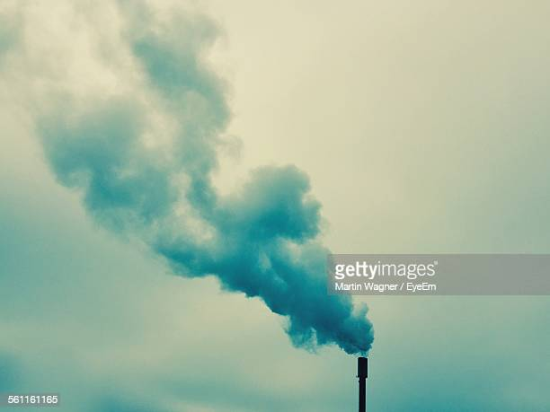 Smoke Emerging From Chimney Against The Sky
