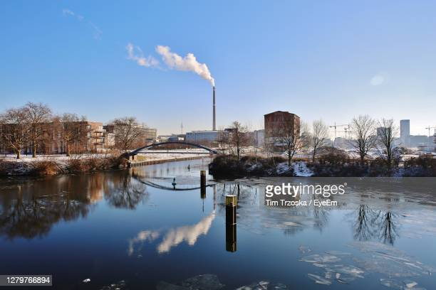 smoke emitting from factory against sky - 2016 stock pictures, royalty-free photos & images