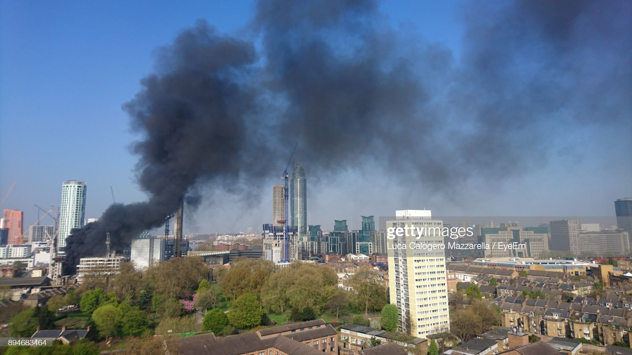 Smoke Emitting From Factory In City Against Sky : Stock Photo