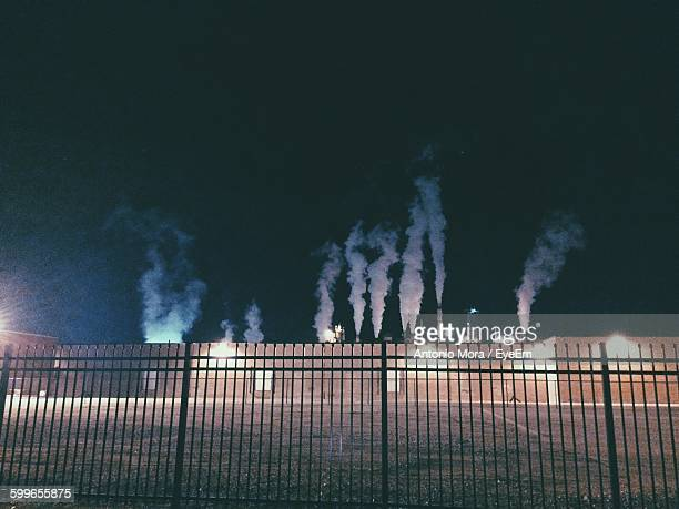 Smoke Emitting From Industry Against Sky At Night