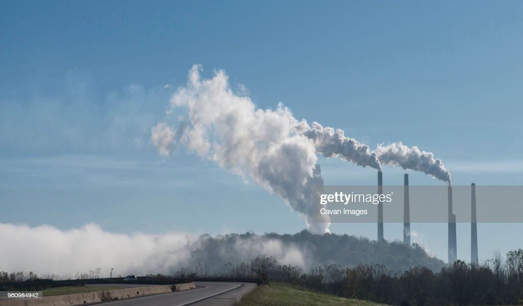 Smoke emitting from industry against sky : Stock Photo