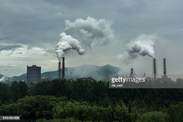 smoke emitting from industry against sky,hangzhou,china - coal fired power station stock photos and pictures
