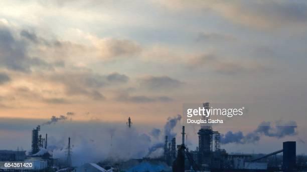 Smoke emitting from oil refiney smoke stacks