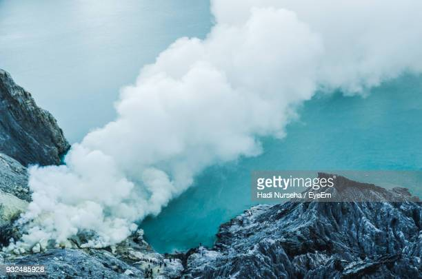 smoke emitting from rocky mountains - bogor stock pictures, royalty-free photos & images