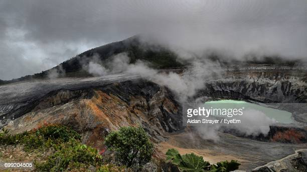 Smoke Emitting From Volcanic Landscape