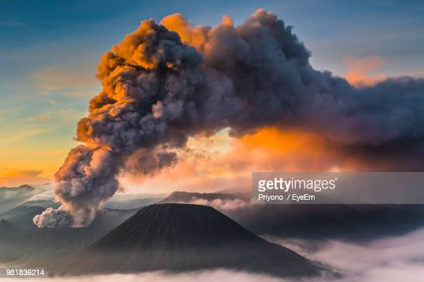 smoke emitting from volcanic mountain against sky during sunset - volcanic activity stock pictures, royalty-free photos & images