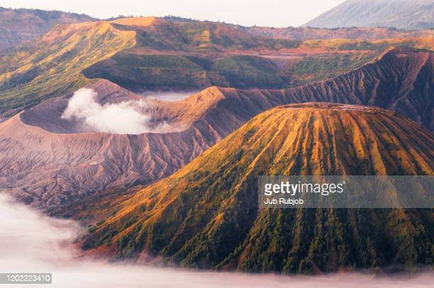smoke emitting from volcano against sky - mt bromo stock pictures, royalty-free photos & images