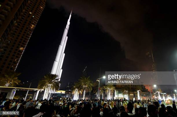 Smoke engulfs the Address Downtown hotel after it was hit by a massive fire near the world's tallest tower Burj Khalifa in Dubai on December 31 2015...