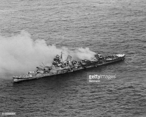 Smoke envelopes a Japanese Navy heavy cruiser of the Mogami Class after it was bombed by US Navy aircraft during the Battle of Midway