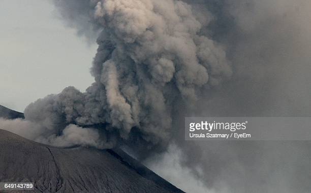 Smoke Erupting From Volcanic Mountain Against Sky