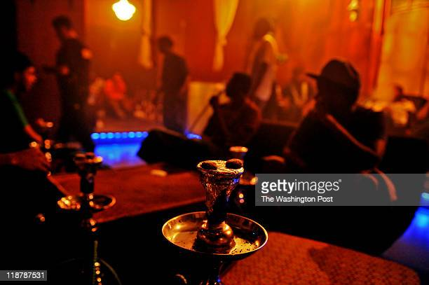 Smoke fills the colorfully lit room of the 280 Hookah bar after midnight on July 1 in St Paul MN This hookah joint is a regular hangout spot for...