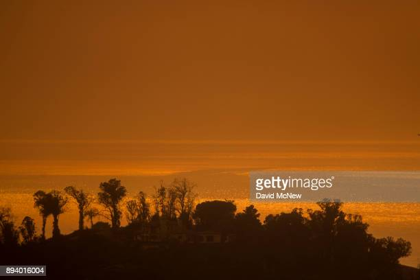 Smoke fills the sky over the ocean beyond homes threatened by the Thomas Fire on December 16 2017 in Montecito California The National Weather...