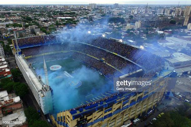 Smoke flares are seen as players walk onto the field before the first leg match between Boca Juniors and River Plate as part of the Finals of Copa...