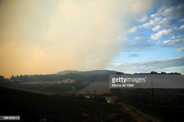 Smoke from a bushfire that is burning out of control at nearby Cherryville hangs over the Adelaide Hills on May 10 2013 in Adelaide Australia The out...