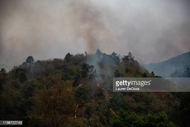 Smoke from a forest fire seen over the mountains on April 19 2019 in Chiang Rai Thailand Thailand's Northern Provinces of Chiang Rai and Chiang Mai...