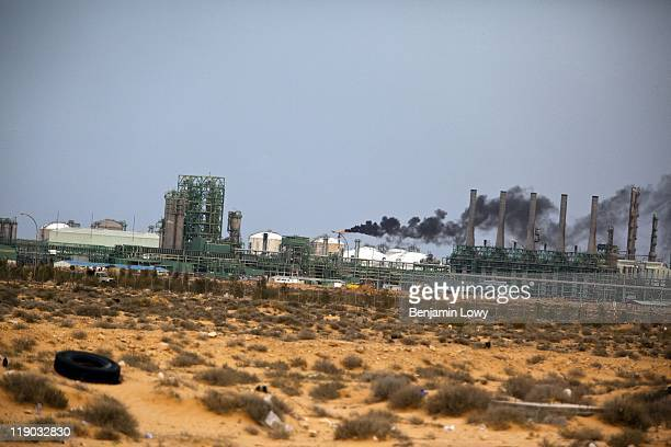 Smoke from a natural gas flare off clouds the sky over the Ras Lanuf oil refinery on March 29 2011 in Ras Lanuf, Libya.