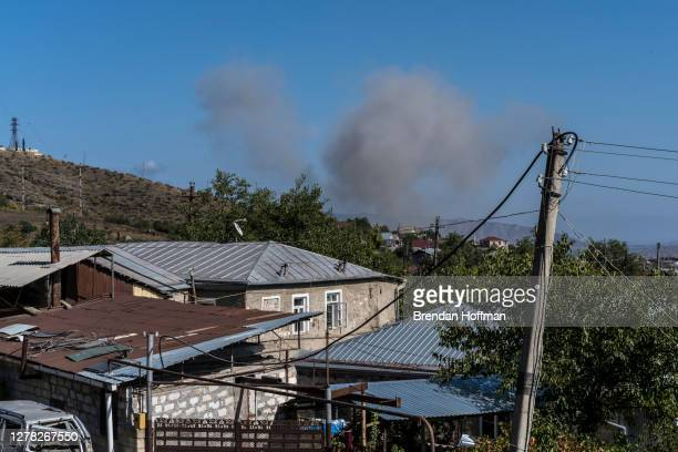 Smoke from a presumed drone or artillery strike on October 3, 2020 in Stepanakert, Nagorno-Karabakh. A decades-old conflict between Armenia and...