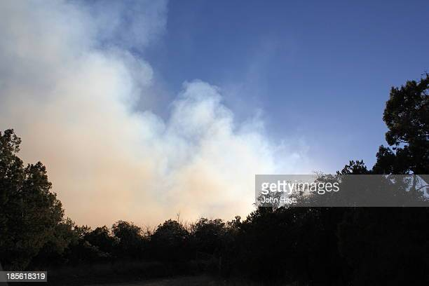 Smoke from a wildfire in the Patagonia Mountains of Santa Cruz County, Arizona.