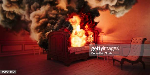smoke from burning bed - inferno stock photos and pictures